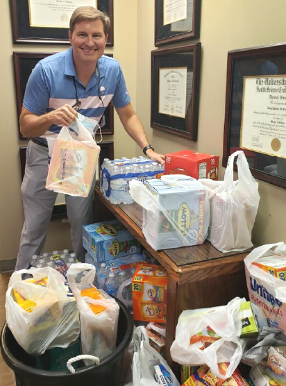 image showing Dr St. Clair with donations